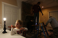 Xavier Mascareñas/Newsday; Piermont Volunteer Fire Chief Danny Goswick's granddaughter Addison Temple, 4, sits at the counter as workers finish a fireplace at the Goswick family home in Piermont. (Nov. 17, 2012)