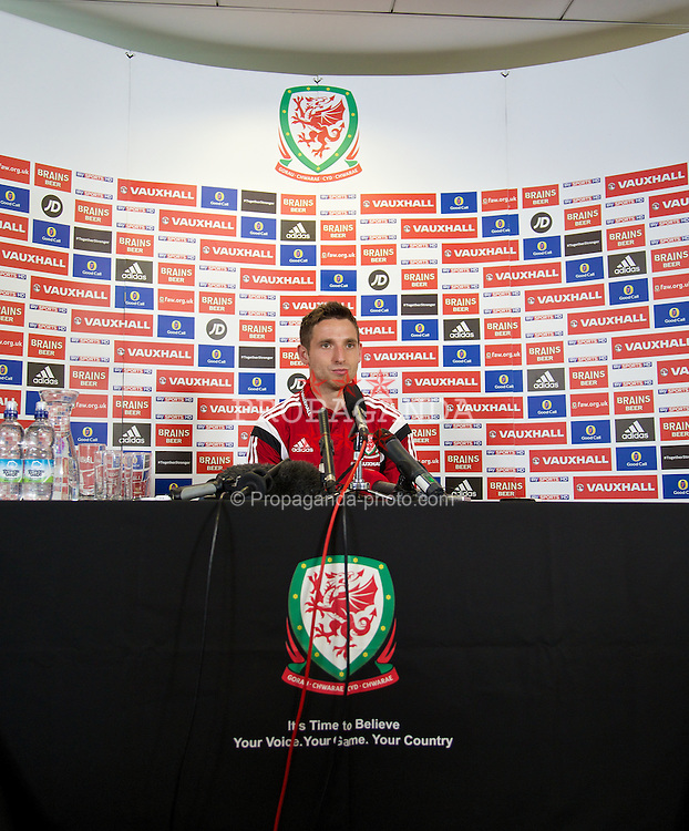CARDIFF, WALES - Wednesday, September 3, 2014: Wales' captain Joe Allen during a press conference at the Millennium Centre in Cardiff ahead of the opening UEFA Euro 2016 qualifying match against Andorra. (Pic by David Rawcliffe/Propaganda)