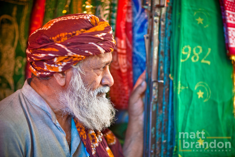 This man sells ornate cloth to be placed on the tomb of Nizamuddin in an act of worship.