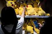A man is playing at Pokemon Go inside the Pokemon store in Ikebukuro. The Japanese version of the game app Pokemon Go was released on July 22, 2016. Japan McDonalds' 3,000 restaurants in Japan will be turned into Pokemon gyms in collaboration with the fast-food chain. 22/07/2016-Tokyo, JAPAN