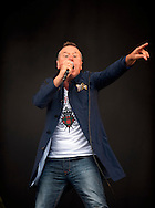 Jim Kerr of Simple Minds performs on stage during T In The Park Festival at Balado on July 7, 2012 in Kinross, United Kingdom. (Photo by Ross Gilmore