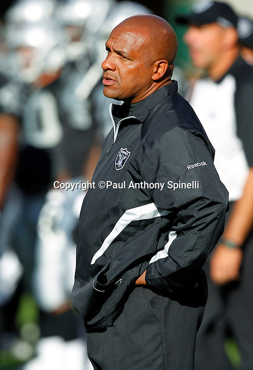 Oakland Raiders Offensive Coordinator Hue Jackson looks on during pregame warmups during the NFL preseason week 3 football game against the San Francisco 49ers on Saturday, August 28, 2010 in Oakland, California. The 49ers won the game 28-24. (©Paul Anthony Spinelli)