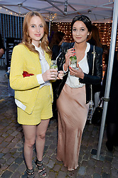 Left to right, ROSIE FORTESCUE and ROXIE NAFOUSI at a private view in aid of Chickenshed of Julian Schnabel's first UK solo show of paintings for 15 years entitled 'Every Angel Has A Dark Side' held at the Dairy Art Centre, 7a Wakefield Street, Bloomsbury, London on 24th April 2014.