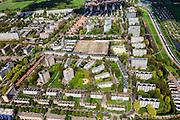 Nederland, Zuid-Holland, Den Haag, 09-05-2013; Mariahoeve, nieuwbouwwijk uit de jaren zestig ('60) van de vorige eeuw. Nadrukkelijke  wegenstructuur met hoofdverkeerswegen en ontsluitingswegen, verdeelt de wijk in buurten met verschillende woningtypes en overvloedige openbaar groen. Wederopbouwgebied. Rechts de Noordelijke Randweg.<br /> New residential area built in the sixties,  The structure of the roads divides the district into neighborhoods with different housing types and many public green areas.<br /> Reconstruction area.<br /> luchtfoto (toeslag op standard tarieven)<br /> aerial photo (additional fee required)<br /> copyright foto/photo Siebe Swart