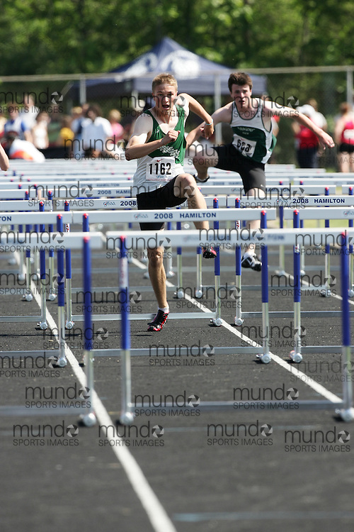 Hamilton, Ontario ---06/06/08--- Gregory MacNeill of Mother Teresa in London competes in the sprint hurdles at the 2008 OFSAA Track and Field meet in Hamilton, Ontario..