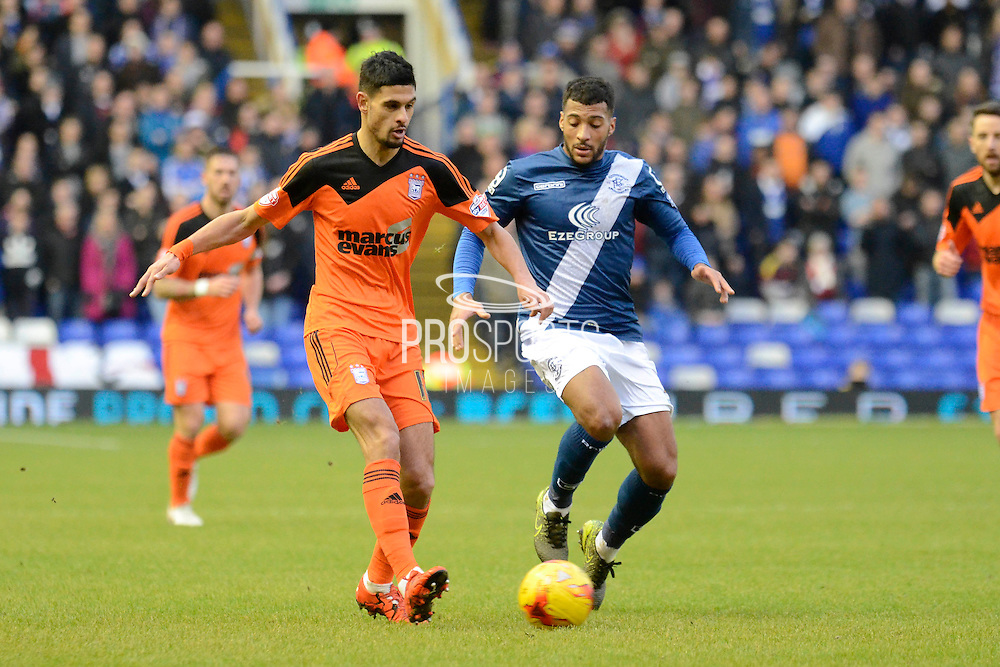 Ipswich Town midfielder Kevin Bru plays the ball away from Birmingham City midfielder David Davis during the Sky Bet Championship match between Birmingham City and Ipswich Town at St Andrews, Birmingham, England on 23 January 2016. Photo by Alan Franklin.