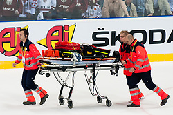 Paramedics going to Radek Martinek of Czech Republic that is lying injured on the ice after hit by Arturs Kulda of Latvia during ice-hockey match between Czech Republic and Latvia of Group D of IIHF 2011 World Championship Slovakia, on April 30, 2011 in Orange Arena, Bratislava, Slovakia. (Photo by Matic Klansek Velej / Sportida)