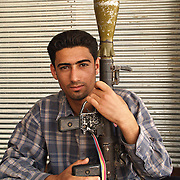 A member of Moqtada al Sadr's Mehdi army holding an RPG in Najaf on the 15th April 2004.