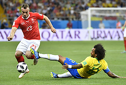 ROSTOV-ON-DON, June 17, 2018  Marcelo (R) of Brazil vies with Xherdan Shaqiri of Switzerland during a group E match between Brazil and Switzerland at the 2018 FIFA World Cup in Rostov-on-Don, Russia, June 17, 2018. The match ended in a 1-1 draw. (Credit Image: © Chen Yichen/Xinhua via ZUMA Wire)
