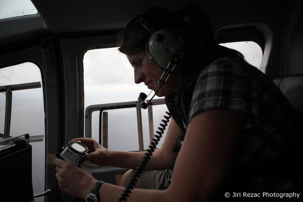 INDIAN OCEAN 23MAR13 - Videographer Sarah Scragg of Australia works aboard the helicopter whilst flying over the Indian Ocean.<br /> <br /> <br /> <br /> The Esperanza is on patrol in the Indian Ocean looking for illegal fishing vessels.<br /> <br /> <br /> <br /> jre/Photo by Jiri Rezac / Greenpeace