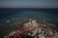 Discarded rubber boats, life vests and belonging used by migrants liter a rocky area on Lesbos shore. Refugees from Afghanistan and Syria arrive in boats on the shores of Lesbos near Skala Sikaminias, Greece on 09<br /> November, 2015. Lesbos, the Greek vacation island in the Aegean Sea between Turkey and Greece, faces massive refugee flows from the Middle East countries.