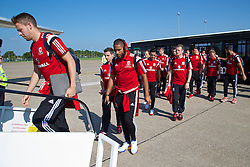 CARDIFF, WALES - Sunday, September 7, 2014: Wales' captain Ashley Williams boards the plane at Cardiff Airport as the squad flies to Andorra ahead of the opening UEFA Euro 2016 qualifying match. (Pic by David Rawcliffe/Propaganda)