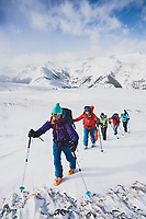 Day three of Intro to Backcountry Skiing with Chicks, LLC. Guide Karen Bockel heads to a high point with Margaret Gorman, Caroline Schweyer, Diane Mielcarz, Jen Edney, and Dara Miles, while out for a tour in the Red Mountain Pass area of the San Juan Mountains, Colorado.
