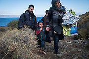 Having just landed in a small boat from Turkey, an Arab family walks up from the beach toward a road on the Greek island of Lesbos. They are among more than 500,000 migrants and refugees who have crossed from Turkey to the Greek islands in 2015.