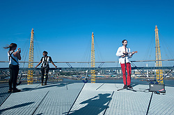 Musician Robbie Boyd plays on top of the O2 Arena.<br /> Up and coming musician Robbie Boyd, who won the Mayor's Gigs Big Busk competition in 2011, plays at the top of the O2 Arena,<br /> London, United Kingdom<br /> Thursday, 18th July 2013<br /> Picture by Piero Cruciatti / i-Images