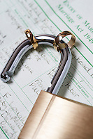 Padlock with two wedding rings on marriage act close-up