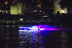 © Licensed to London News Pictures. 25/07/2012. London, UK. A colourful illuminated boat passes the Tower of London on 24 July 2012 in a rehearsal event believed to be related to the opening ceremony of the London 2012 Olympic Games. Photo credit : Vickie Flores/LNP