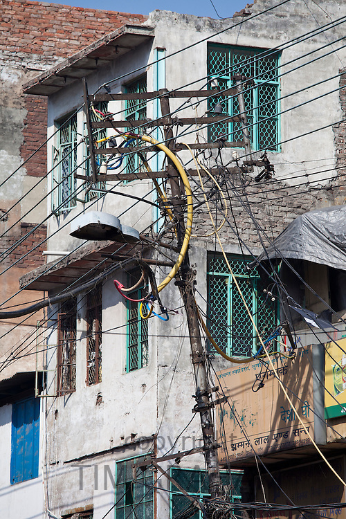 Electricity pylon at Khari Baoli, Old Delhi, India