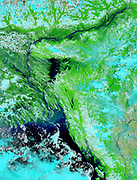 Large areas of parts Bangladesh (left of centre) and India (left edge and upper right) are under water,3 August 2003.  Bright blue is rivers, lakes and flooded areas.  Dark area left foreground is Bay of Bengal. Credit NASA.