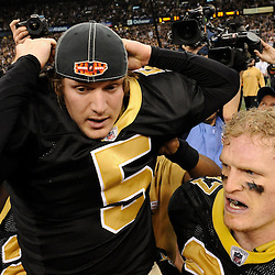 Jan 24, 2010; New Orleans, LA, USA; New Orleans Saints PK Garrett Hartley (5) rides on the shoulders on teammates as he puts on a Super Bowl XLIV hat after kicking a game winning field goal against the Minnesota Vikings in overtime of the 2010 NFC Championship game at the Louisiana Superdome. Mandatory Credit: Derick E. Hingle-US PRESSWIRE