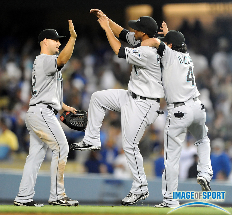 Jul 11, 2008; Los Angeles, CA, USA; From left: Cody Ross (12), Robert Andino (11) and Alfredo Amezaga (40 of the Florida Marlins celebrate after 3-1 victory over the Los Angeles Dodgers at Dodger Stadium.