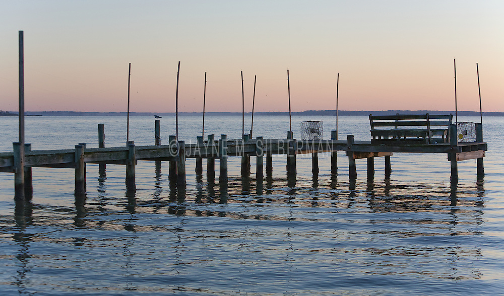 Empty crab pots lie at the edge of this Maryland bay dock