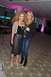 Left to right, KELLY HOPPEN and GABY ROSLIN at a private view of photographs by Joanna Vestey entitled 'Dreams For My Daughter' in aid of The White Ribbon Alliance, held at The Royal Festival Hall, South Bank, London on 8th March 2012.