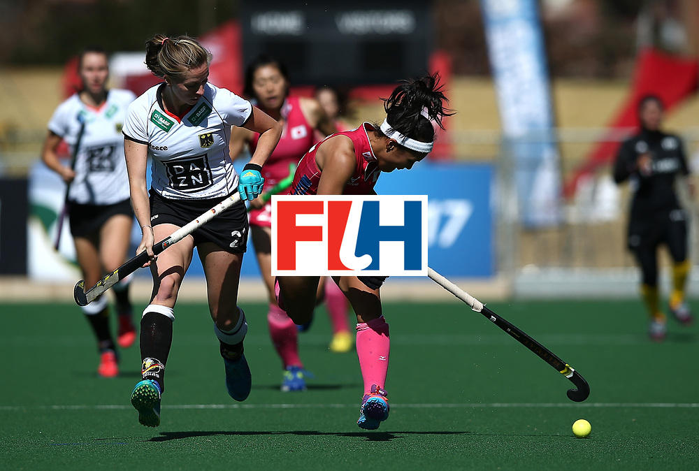JOHANNESBURG, SOUTH AFRICA - JULY 16:  Motomi Kawamura of Japan battles with Franziska Hauke of Germany during day 5 of the FIH Hockey World League Women's Semi Finals Pool A match between Japan and Germany at Wits University on July 16, 2017 in Johannesburg, South Africa.  (Photo by Jan Kruger/Getty Images for FIH)