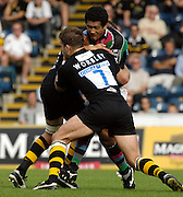 Wycombe, GREAT BRITAIN, Quins Chris HALA'UFIA, is cought by Wasps Joe WORSLEY and John HART, during the Guinness Premiership match, London Wasps vs NEC Harlequins, at Adams Park,  Wycombe, ENGLAND, 17/09/2006. [Photo, Peter Spurrier/Intersport-images].