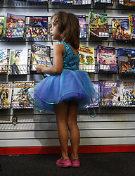 May 4, 2019 - Cincinnati, Ohio, USA - Five year old  Bree Myers  looks over Comic Book for Comic books with woman flyers  in them  at Rocking Rooster Comic and Game shop .  On Sat May 4 2019 on Free Comic Book Day. Were you can get 3 some of the New Books this day. (Credit Image: © Ernest Coleman/ZUMA Wire)