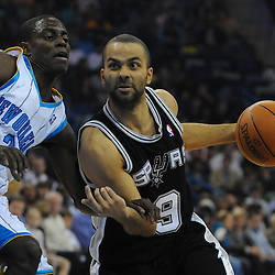 Jan 18, 2010; New Orleans, LA, USA; San Antonio Spurs guard Tony Parker (9) drives past New Orleans Hornets guard Darren Collison (2) during the first half at the New Orleans Arena. Mandatory Credit: Derick E. Hingle-US PRESSWIRE