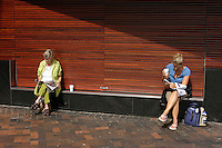 Two women reading in Circular quay, Sydney, Australia. January 2nd-11th 2007