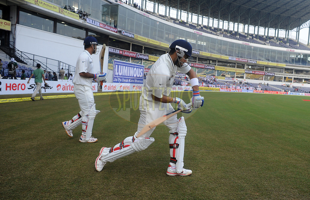 Virat Kohli of India and MS Dhoni captain of India walk to bat at the start of the play on day three of the 4th Airtel Test Match between India and England held at VCA ground in Nagpur on the 15th December 2012..Photo by  Pal Pillai/BCCI/SPORTZPICS .