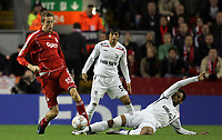 Photo: Paul Thomas/Sportsbeat Images.<br /> Liverpool v Besiktas. UEFA Champions League. 06/11/2007.<br /> <br /> Peter Crouch (Red) of Liverpool keeps the ball from Edouard Cisse of Besiktas (Ground).