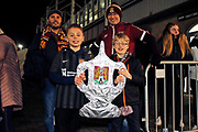 Northampton Town fans with tin foil FA Cup trophy before the The FA Cup match between Northampton Town and Derby County at the PTS Academy Stadium, Northampton, England on 24 January 2020.