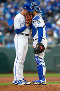 March 29, 2018 - Kansas City, MO, U.S. - KANSAS Kansas City, MO - MARCH 29: Kansas City Royals talk on the mound during the major league opening day game against the Chicago White Sox on March 29, 2018 at Kauffman Stadium in Kansas City, Missouri. (Photo by William Purnell/Icon Sportswire) (Credit Image: © William Purnell/Icon SMI via ZUMA Press)