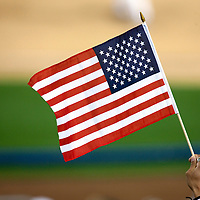 22 March 2009: A fan of the USA waves a flag during the 2009 World Baseball Classic semifinal game at Dodger Stadium in Los Angeles, California, USA. Japan wins 9-4 over Team USA.