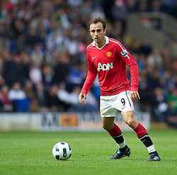 BOLTON, ENGLAND - Sunday, September 26, 2010: Manchester United's Dimitar Berbatov in action against Bolton Wanderers during the Premiership match at the Reebok Stadium. (Photo by David Rawcliffe/Propaganda)