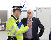 Sadia Khan at London's Night Tube launch at Brixton tube station, London, Great Britain <br /> 19th August 2016 <br /> <br /> <br /> Paul Crowther Chief Constable BTP talks to Leon daniels MD Surface Transport TFL <br /> <br /> Sadia Khan, mayor of London,  launched the first night tube service and travelled on a tube train between Brixton and Walthamstow on the Victoria Line. <br />  <br /> He launched the first 24 hour Friday and Saturday night services on the Central and Victoria lines <br /> <br /> Photograph by Elliott Franks <br /> Image licensed to Elliott Franks Photography Services