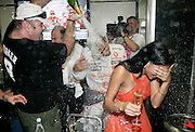 New Formula One World Champion Lewis Hamilton of Great Britain and McLaren Mercedes is covered in champagne as he celebrates with his girlfriend, Pussycat Doll singer Nicole Scherzinger, following the Brazilian Formula One Grand Prix at the Interlagos Circuit on November 2, 2008 in Sao Paulo, Brazil...