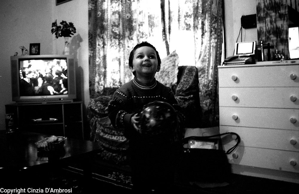 Vera, Kosovo refugee in her temporary accomodation in East London. The majority of refugees that arrive in the Uk are offered provisional housing, vouchers to buy food and are not allowed to seek employment.  This situation supposed to be temporary often takes years to settle, so many like Vera even after 5 years still do not know whether they have their right to stay permanently. Many  see themselves as living in a limbo, unable to look for work and to move freely.  Often the bond between the community of refugees is strong supported by the need to keep some of their culture and costumes alive.