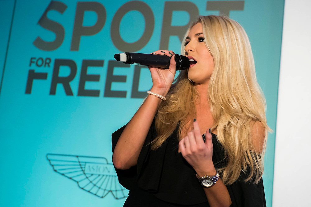 Holly an X factor contestant sings - UK charity, Sport for Freedom (SFF), marks Anti-Slavery Day 2015 by hosting a charity Gala Dinner, supported by Aston Martin, on Thursday 15th October at Stamford Bridge, home of Chelsea Football Club. This inaugural event brought together people from the world of sport, entertainment, media, and business to unite behind a promise to tackle the issue of modern day human trafficking and slavery.  <br /> Hosted by Sky presenters Sarah-Jane Mee and Jim White, the Sport for Freedom Gala Dinner includes guests such as jockey AP McCoy OBE; Denise Lewis, former British Olympic Gold Medal winner; BBC Strictly star, Brendan Cole; Al Bangura, former Watford FC player and Sport for Freedom Ambassador who was trafficked from Africa to the UK at the age of just 14yrs old; Made in Chelsea star, Ollie Proudlock; ITV weather presenter, Lucy Verasamy; Sky Sports F1 presenter and SFF Ambassador, Natalie Pinkham; Premier League footballers Ryan Bertrand of Southampton FC and Troy Deeney of Watford FC and champion boxer, Anthony Joshua; and The UK's first independent Anti Slavery Commissioner, Kevin Hyland OBE, who highlighted the issues of modern day slavery that face the UK and world today. <br /> The evening concluded with chart topping music from 'Naughty Boy'. <br /> Sport for Freedom are also joining forces with the Premier League Academies for an international  'Football for Freedom' tournament with their U16's players that will also involve educating those taking part about the issues surrounding modern day slavery. The final will take place at Liverpool FC's Academy on Anti-Slavery Day, 18th October.