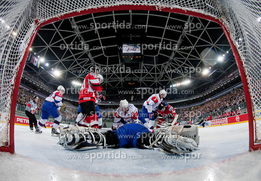 Robert Kristan of Slovenia  tries to cover a puck during ice-hockey match between Austria and Slovenia at IIHF World Championship DIV. I Group A Slovenia 2012, on April 21, 2012 at SRC Stozice, Ljubljana, Slovenia. (Photo By Matic Klansek Velej / Sportida.com)