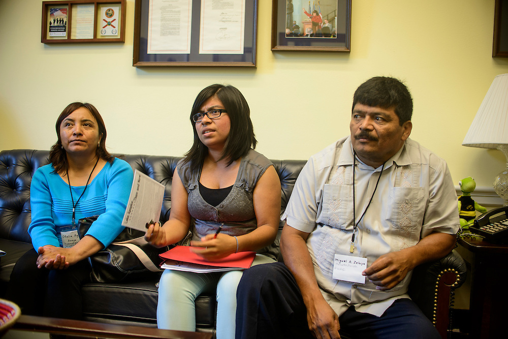 Photo by Matt Roth<br /> <br /> Florida Farmworker Fly In constituents Ofelia Aguilar, left, Selena Zelaya, middle, and her father Miguel Zelaya, meet with Lee Footer, Legislative Assistant for Agriculture &amp; Environmental Policy for Rep. Corrine Brown at the Rayburn House Building in Washington, D.C. on Tuesday, July 16, 2013.
