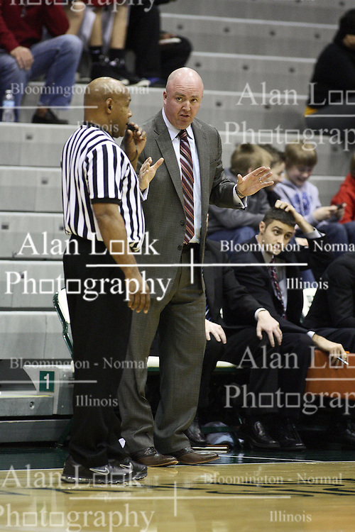 15 December 2012:  Mike McGrath works on convincing an official during an NCAA mens division 3 basketball game between theUniversity of Chicago Maroons and the Illinois Wesleyan Titans in Shirk Center, Bloomington IL