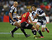 Bryan Habana takes on Lionel Mapoe during the Super Rugby (Super 15) fixture between the DHL Stormers and the Lions held at DHL Newlands Stadium in Cape Town, South Africa on 26 February 2011. Photo by Jacques Rossouw/SPORTZPICS