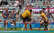 Jack Littlejohn of Salford Red Devils  tackled by strong Catalans Dragons  tackle during the Betfred Super League match at the Dacia Magic Weekend, St. James's Park, Newcastle<br /> Picture by Stephen Gaunt/Focus Images Ltd +447904 833202<br /> 20/05/2018