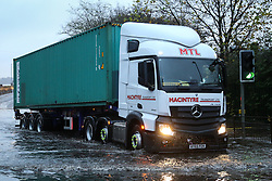 © Licensed to London News Pictures. 22/11/2016. Rotherham, UK. A truck ploughs through a flooded road in Rotherham, South Yorkshire, after a river broke it's banks last night. Storm Angus has brought heavy wind and rain to much of the UK this week with flooding seen all over. Photo credit : Ian Hinchliffe/LNP