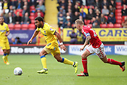 AFC Wimbledon striker Andy Barcham (17) dribbling away from Charlton Athletic midfielder Chris Solly (20) during the EFL Sky Bet League 1 match between Charlton Athletic and AFC Wimbledon at The Valley, London, England on 28 October 2017. Photo by Matthew Redman.