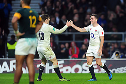 Try-scorer George Ford of England high-fives team-mate Elliot Daly - Mandatory byline: Patrick Khachfe/JMP - 07966 386802 - 12/11/2016 - RUGBY UNION - Twickenham Stadium - London, England - England v South Africa - Old Mutual Wealth Series.